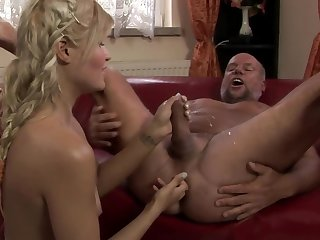A hot blonde is playing thither the dude's ass and she is peeing