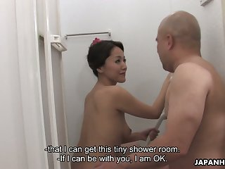 Busty Asian milf Nao Kato finger fucks pussy and gives a blowjob with the shower