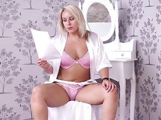 Chubby blond milf Ashley Rider is reading off colour N in sexy lingerie