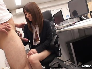 Naughty Asian co-worker Kimoko Tsuji gives a footjob together with blowjob in all directions someone's skin assignation