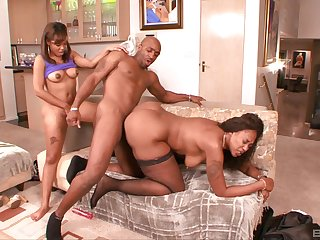 Black supplicant rams both these thick ebony sluts in a rough play