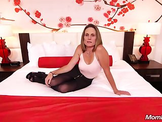 Skinny brunette milf with saggy tits, Judith, is riding a hard washed out cock for a camera